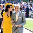 George Clooney et sa femme Amal arrivent à la chapelle S. George pour le mariage du prince Harry et de Meghan Markle au château de Windsor, Royaume Uni, le 19 mai 2018.