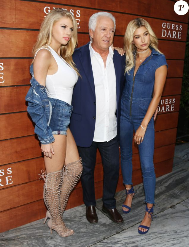Charlotte McKinney, Paul Marciano et Hailey Baldwin à Los Angeles, le 27 juillet 2016.