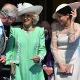 Le prince Charles, la duchesse Camilla et la duchesse Meghan (Meghan Markle) le 22 mai 2018 lors d'une des fameuses garden parties de Buckingham Palace, à Londres.