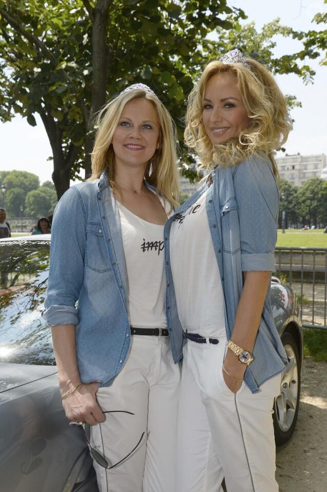 Natalia Sklenarikova (soeur d' Adriana) et Adriana Karembeu - 15 ème Rallye des Princesses à Paris - Journée des vérifications des voitures, Esplanade des Invalides. Paris, le 31 mai 2014