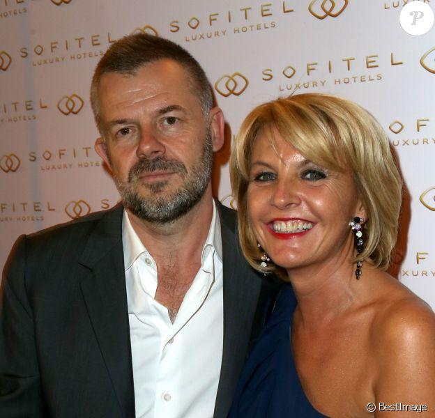 Eric Naulleau et sa femme Veronika à la soiree d'inauguration de l'hotel Sofitel Paris Arc de Triomphe au 14 Rue Beaujon a Paris le 18 septembre 2013.
