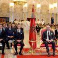 La princesse Lalla Khadija avec son père le roi Mohammed VI du Maroc et le prince héritier Moulay El Hassan le 17 septembre 2018 au palais royal à Rabat lors d'une cérémonie pour la présentation du bilan de la réforme en cours du système éducatif.