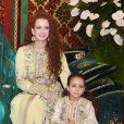 La princesse Lalla Salma du Maroc et sa fille la princesse Lalla Khadija lors du mariage du prince Moulay Rachid et d'Oum Keltoum le 13 novembre 2014 au palais royal à Rabat.