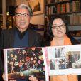 """Kenzo Takada et Kazuko Masui à la séance de dédicaces du livre de Mme Kazuko Masui """"Kenzo Takada"""" à la librairie Artcurial à Paris, le 21 novembre 2018. © Guirec Coadic/Bestimage"""