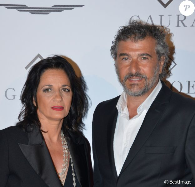 "Exclusif - Daniel Lévi et sa compagne Sandrine Aboukrat au dîner caritatif ""The Global Gift Initiative"" au Carlton Beach Club lors du 71ème Festival International du Film de Cannes, le 11 mai 2018. © CVS/Bestimage"