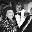 Johnny Hallyday, Régine et son mari Roger Choukroun lors d'une soirée à Paris en 1978.