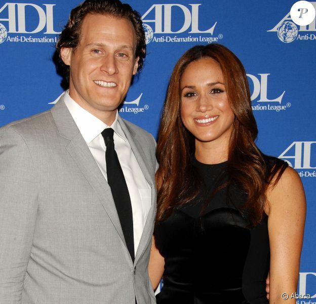 Trevor Engelson et Meghan Markle lors d'un événement à Los Angeles le 11 octobre 2011