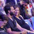 Maxim Nucci (Yodelice) et Isabelle Ithurburu, alors enceinte de leur fille Mia, en juin 2018 au Palais des Sports de Paris lors d'un match de boxe de Tony Yoka. © Veeren-CVS/Bestimage
