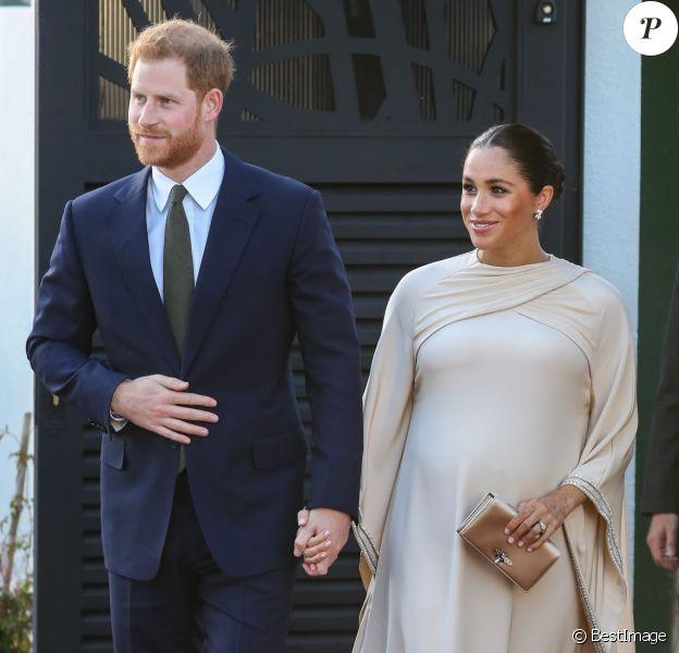 Le prince Harry, duc de Sussex, et Meghan Markle, duchesse de Sussex, enceinte assistent à une réception organisée par l'ambassadeur britannique au Maroc, à la résidence britannique de Rabat, le 24 février 2019.