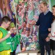 Kate Middleton, duchesse de Cambrudge, et le prince William à Windsor Park, à Belfast, le 27 février 2019 lors d'une rencontre avec la Irish Football Association.