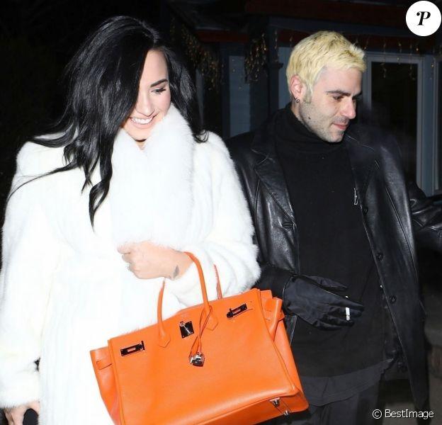 Exclusif - Demi Lovato et son compagnon Henri Levy sortent d'un dîner en amoureux à Aspen le 2 janvier 2019.