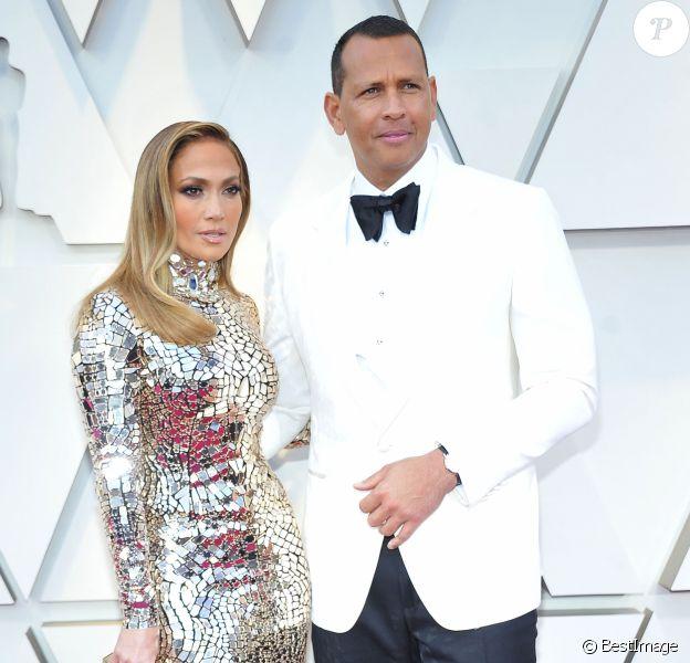 Jennifer Lopez et son compagnon Alex Rodriguez lors du photocall des arrivées de la 91ème cérémonie des Oscars 2019 au théâtre Dolby à Hollywood, Los Angeles, Californie, Etats-Unis, le 24 février 2019.