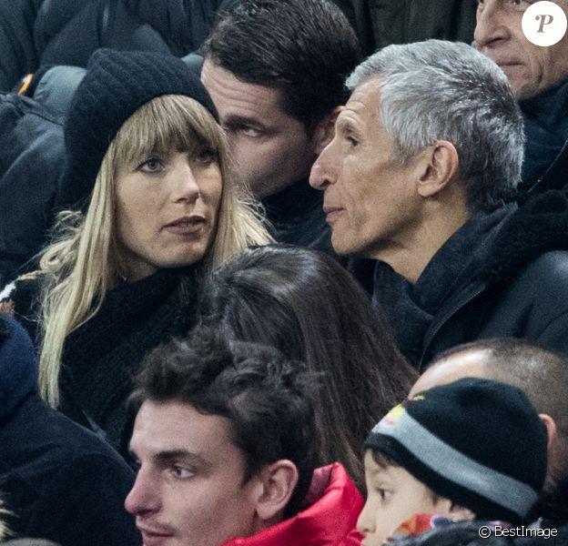 Nagui et sa femme Mélanie Page - People assistent au match des éliminatoires de l'Euro 2020 entre la France et l'Islande au Stade de France à Saint-Denis le 25 mars 2019. La france a remporté le match sur le score de 4-0.