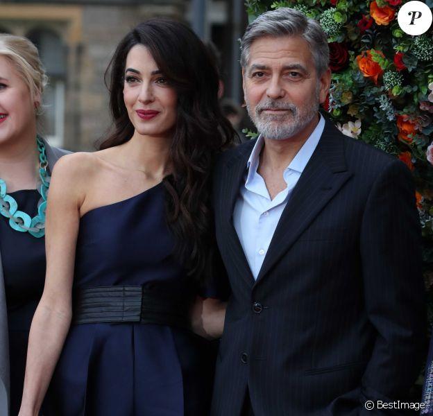 """George Clooney et sa femme Amal arrivent à l'événement """"Postcode Lottery Charity Gala"""" au McEwan hall à Edimbourg le 14 mars 2019."""
