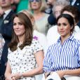 "Catherine (Kate) Middleton, duchesse de Cambridge et Meghan Markle, duchesse de Sussex assistent au match de tennis Nadal contre Djokovic lors du tournoi de Wimbledon ""The Championships"", le 14 juillet 2018."