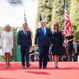 Le président français Emmanuel Macron et sa femme Brigitte, le président des Etats-Unis Donald Trump et sa femme Melania - Commémorations au cimetière américain lors du 75ème anniversaire du débarquement en Normandie. Le 6 juin 2019.