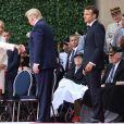 Le président Donald Trump, le président Emmanuel Macron, Brigitte Macron lors de la cérémonie franco - américaine au cimetière américain de Colleville sur Mer le 6 juin 2019 dans le cadre du 75ème anniversaire du débarquement. © Stéphane Lemouton / Bestimage