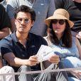 Frédéric Chau et sa compagne enceinte dans les tribunes lors des internationaux de tennis de Roland Garros à Paris, France, le 2 juin 2019. © Jacovides-Moreau/Bestimage