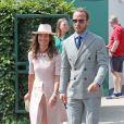 Pippa Middleton (Matthews) et son frère James Middleton (habillé en Ralph Lauren) assistent au championnat de Wimbledon à Londres, le 8 juillet 2019.