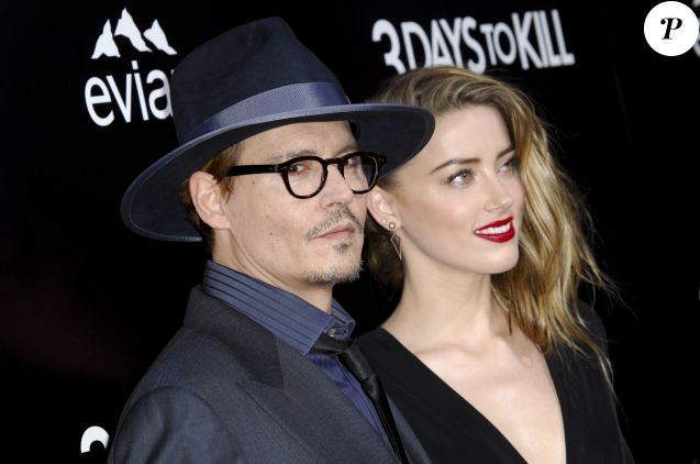 "Johnny Depp et sa fiancée Amber Heard - Première du film ""3 Days to Kill"" à Hollywood, le 12 février 2014."