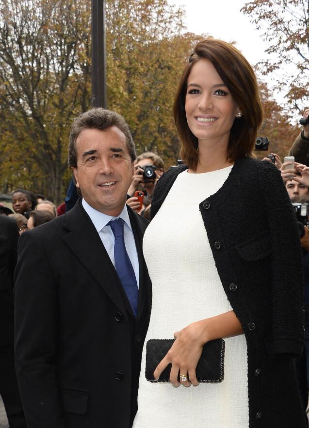 """Arnaud Lagardere et Jade Foret - People au defile de mode """"Chanel"""", collection pret-a-porter printemps-ete 2014, au Grand Palais a Paris le 1er octobre 2013"""