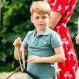Le prince George de Cambridge et sa soeur la princesse Charlotte de Cambridge lors d'un match de polo disputé par le prince William à Wokinghan dans le Berkshire le 10 juillet 2019.