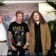 """Jean-Claude Camus, Johnny Hallyday et Yvan Cassar - Johnny Hallyda donne une conférence de presse pour sa tournée """"Flashbak Tour"""" dans le salon d'honneur de Paris Bercy le 31 mai 2006."""