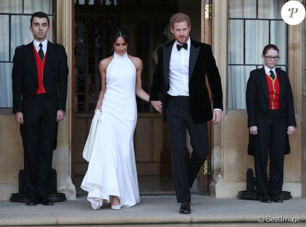 """Meghan Markle et le prince Harry au château de Windsor à bord d'une Jaguar Type E cabriolet en tenue de soirée après leur cérémonie de mariage, pour se rendre à la réception à """"Frogmore House"""" à Windsor le 19 mai 2018."""