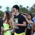 Exclusif - Alexis Ren se balade main dans la main avec sa compagne Milo Manheim au 2ème jour du Festival de Coachella 2019 à Indio dans la zone désertique de la Californie du sud, le 14 avril 2019