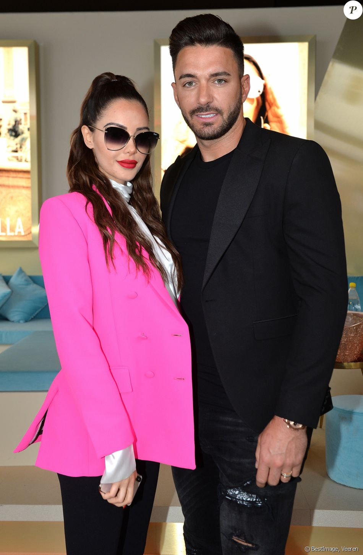 Nabilla Benattia (enceinte) et son mari Thomas Vergara - Nabilla Benattia présente sa collaboration pour les lunettes Quay Australia sur la plage Magnun lors du 72ème Festival International du Film de Cannes, le 18 mai 2019. ©Veeren / Bestimage