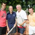 Cédric Pioline, Patrick Le Lay, Christian Bîmes et Gilles Pelisson lors d'un tournoi de tennis en marge de Roland-Garros, en juin 2006.