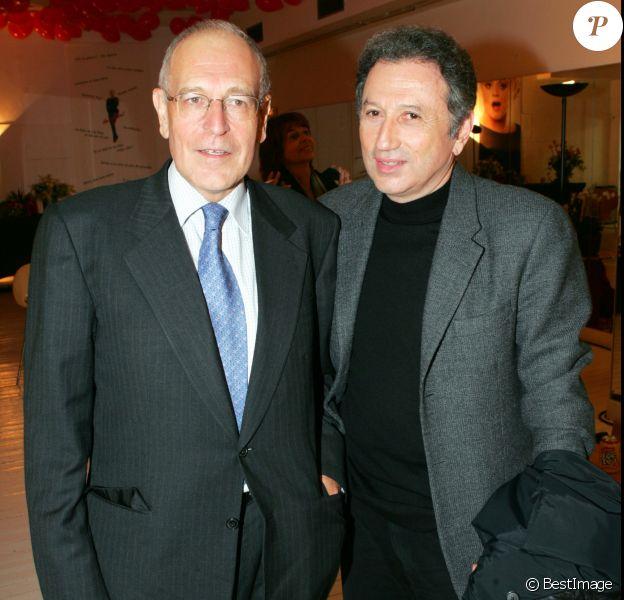 Patrick Le Lay et Michel Drucker en janvier 2005 à la générale du spectacle de Muriel Robin, au Grand Rex à Paris.