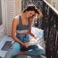 Iris Mittenaere, au balcon de son appartement, à Paris. Mars 2020.