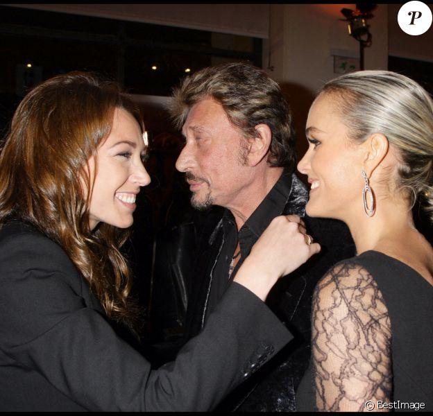 Laura Smet et Laeticia Hallyday avec Johnny en 2008 au Petit Palais à Paris lors du vernissage d'une exposition de Patrick Demarchelier.