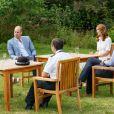 Le prince William et Kate Middleton lors d'une rencontre avec des travailleurs de santé mobilisés pendant la crise santiaire et soutenus par la Royal Foundation, le 23 juillet 2020 à Sandringham.