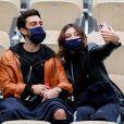Rachel Legrain-Trapani et son compagnon Valentin Léonard dans les tribunes du tournoi de tennis des Internationaux de Roland Garros à Paris. Le 3 octobre 2020 © Dominique Jacovides / Bestimage