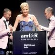 Dean et Dan Caten et Simona Ventura au gala de l'amfAR organisé dans le cadre de la Fashion Week de Milan. 28/09/09