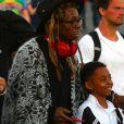 Exclusif - Lil Wayne arrive en famille au Hard Rock Stadium pour assister avec sa compagne La'Tecia Thomas, et son fils Dwayne, au 54 ème Super Bowl à Miami, le 2 février 2020. Le mannequin australien La'Tecia Thomas arborait fièrement sa bague de fiançailles. Les Chiefs de Kansas City remportent le Super Bowl (31 - 20) face aux 49ers de San Francisco, notamment grâce au quarterback P. Mahomes (15).