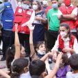 La reine Letizia d'Espagne échange avec des victimes des ouragans Iota et Eta à La Lima au Honduras le 15 décembre 2020.
