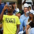 Le joueur français Gaël Monfils fait des photos depuis la tribune à l'US Open le 3 septembre 2019. Il regarde le quart de finale féminin qui oppose Elina Svitolina à Johanna Konta.