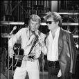 Eddy Mitchell et Johnny Hallyday à la télévision en 1980.