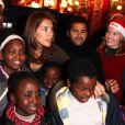 Jamel Debbouze et Melissa Theuriau au Noël du Secours Populaire au Cirque d'Hiver le 23/12/09