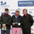 Un participant, Philippe Lavil et Hubert Auriol lors du tournoi de golf des personnalités à Guyancourt le 15 octobre 2010