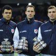 Jo-Wilfried Tsonga, Michael Llodra et Julien Benneteau. L'Equipe de France de tennis a perdu en finale de la Coupe Davis contre la Serbie, le 5 décembre 2010