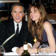 Richard Berry et son amie Pascale au restaurant Gioia, au VIP Room, le 7 décembre 2010. Présentation du dernier bijou d'Edouard Nahum.