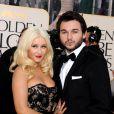 Christina Aguilera et Matthew Rutler lors de la 68e cérémonie des Golden Globes au Beverly Hilton Hotel de Los Angeles le 16 janvier 2011