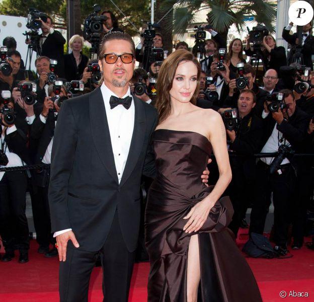 Brad Pitt et la sublime Angelina Jolie lors de la montée des marches de The Tree of Life, dans le cadre du 64e Festival de Cannes, le 16 mai 2011.