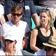 Nathalie Vincent et un ami au tournoi de Roland-Garros, le 2 juin 2011.