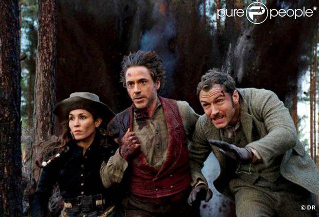 Noomi Rapace, Robert Downey Jr. et Jude Law dans  Sherlock Holmes 2 , en salles le 25 janvier 2012.