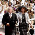 Le pilote de course Jacky Stewart et sa femme Helen arrivent dans la cour d'honneur du Palais princier où se déroule la cérémonie de mariage du Prince Albert avec Charlene Wittstock, le 2 juillet 2011 à Monaco